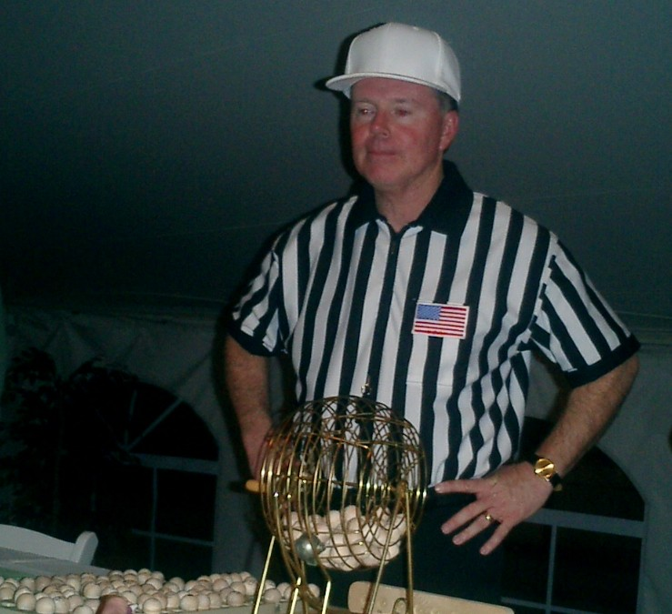 Replacement referee Craig Ochoa seen conducting a raffle in 2004. Credit: carolstreamchamber.com