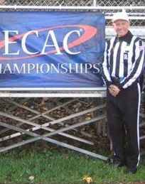 Referee Jerry Hughes before an ECAC postseason game in 2011. Credit: Eastern