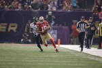 Head linesman Steve Stelljes gives chase after a catch by 49ers receiver Michael Crabtree. (San Francisco 49ers photo)
