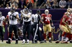 Umpire Darrell Jenkins gets ready to spot the ball after a sack by Ravens linebacker Paul Kruger. (Perry Knotts/NFL)